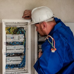 Opp AL electrician inspecting circuit panel