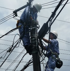 Oxford AL electricians working on power lines